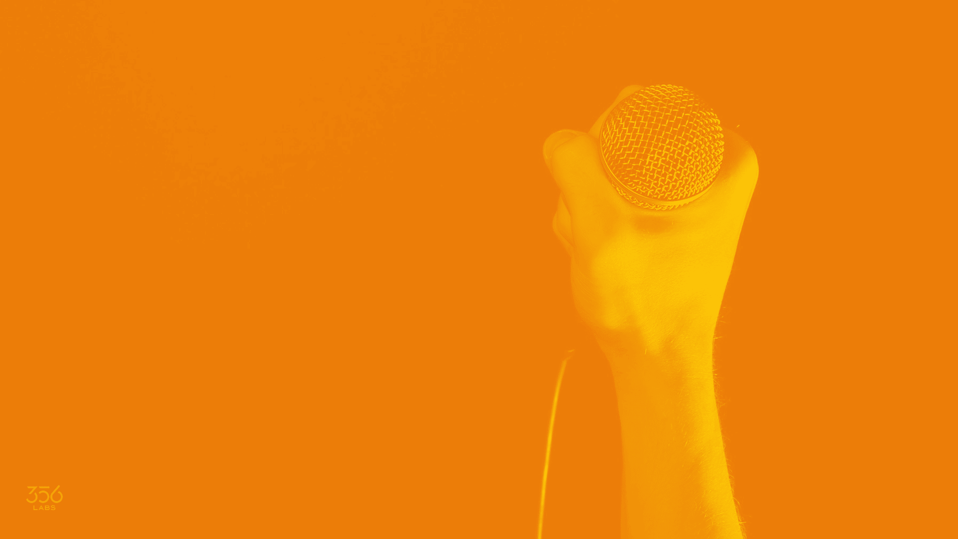 Image of a hand holding a microphone